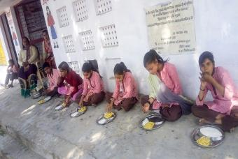 Freshly cooked 'Khichdi' is served to children
